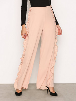 Missguided persikofärgade byxor Frill Side Wide Trousers Beige
