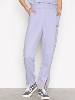 Cheap Monday omönstrade byxor Haste trousers Small skul Lilac