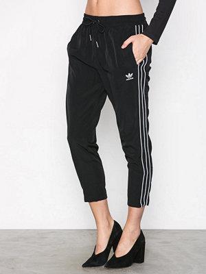 Adidas Originals omönstrade byxor SC Pant Svart