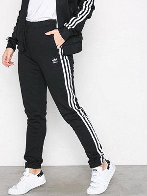 Adidas Originals svarta byxor Regular TP Cuf Svart