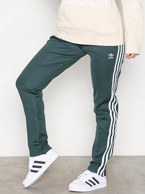 Adidas Originals omönstrade byxor Sst Tp Grön