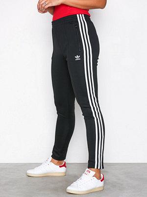 Adidas Originals svarta byxor Sst Tp Svart