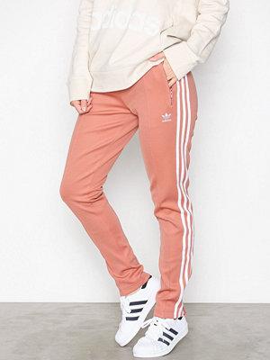 Adidas Originals omönstrade byxor Sst Tp Rosa