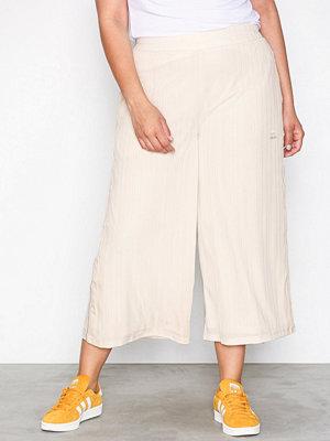 Adidas Originals omönstrade byxor SC Pant Rib Linen