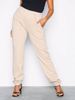 NLY Trend omönstrade byxor Cozy Sweat Pants Beige