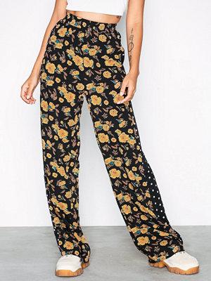 Moves mönstrade byxor Utalja Sunflower
