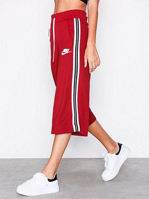 Nike röda byxor NSW Pant