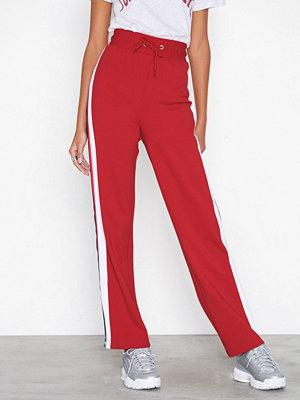 Tommy Jeans röda byxor Tjw Zipper Pant