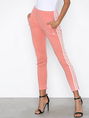 Adidas Originals omönstrade byxor SST Tracksuit Pants Rose