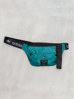 Adidas Originals mörkgrön axelväska Funny Pack S Grön