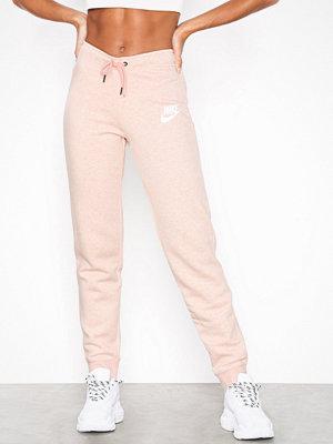 Nike omönstrade byxor NSW Rally Pant Tight rosa/vit