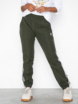 Adidas Originals omönstrade byxor Regular TP Cuff Grön