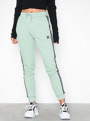 Adidas Originals omönstrade byxor Cuf Pant Grön