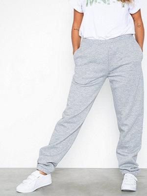 NLY Trend omönstrade byxor Cozy Sweat Pants Grå Melange