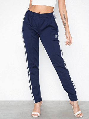 Adidas Originals marinblå byxor Sst Tp