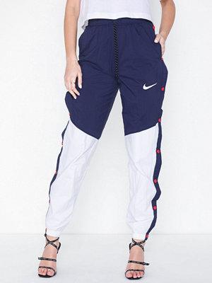 Nike omönstrade byxor NSW R Pant Popper