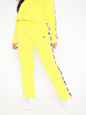 Nike gula byxor NSW Pant Logo Tape Popper