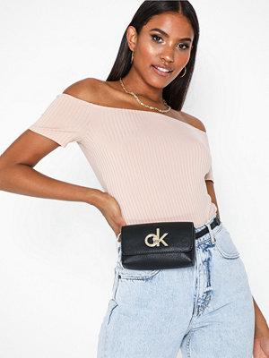 Calvin Klein svart axelväska Re-Lock Waistbag