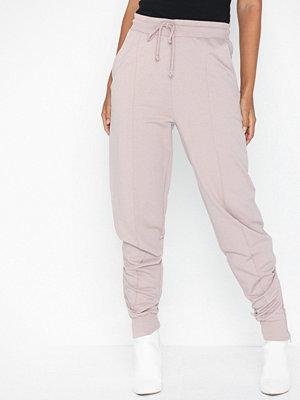 NLY Trend ljusgrå byxor Zip Joggers