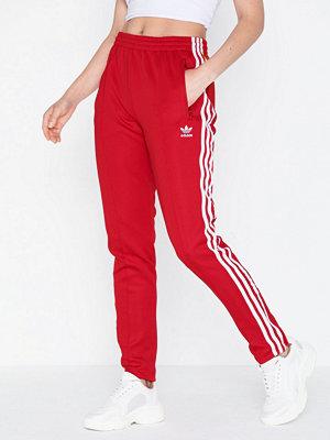 Adidas Originals röda byxor Sst Tp