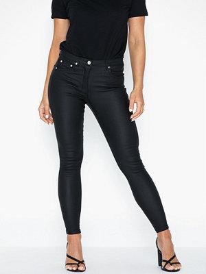 Parisian svarta byxor Coated Mid Rise Skinny Jeans