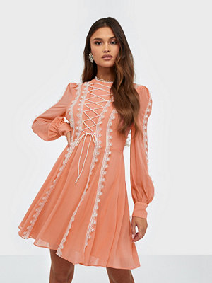 True Decadence Long Sleeve Lacing Mini Dress