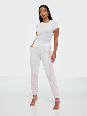 Nike omönstrade byxor W Nsw Jogger Pant Ft Cb