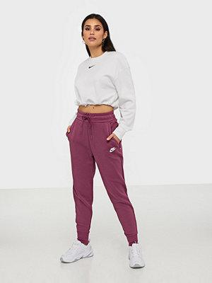 Nike rosa byxor W Nsw Tch Flc Pant