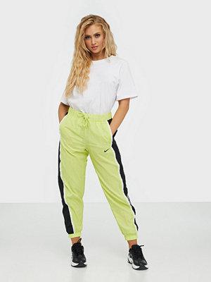 Nike limegröna byxor W Nsw Pant Wvn Piping