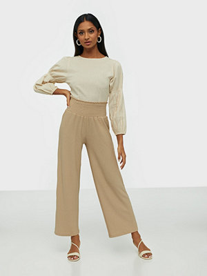 Pieces omönstrade byxor Pccurli Hw Cropped Pants