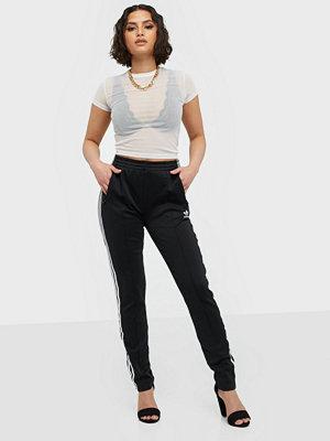 Adidas Originals svarta byxor Ss Tp