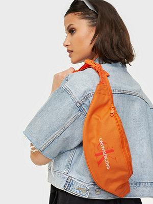 Calvin Klein Jeans orange väska STREETPACK