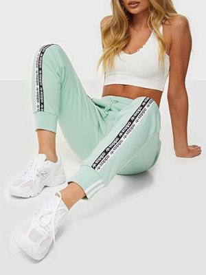 Adidas Originals omönstrade byxor Cuff Pant