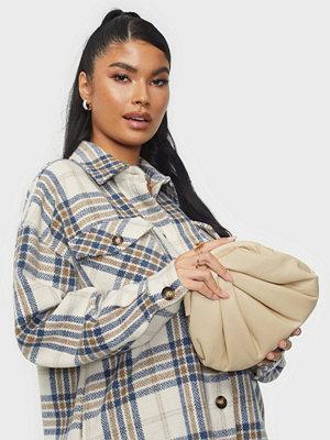 NuNoo omönstrad väska Mini Saki smooth