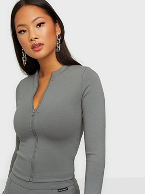 Nicki Studios Long Sleeve Zip Top