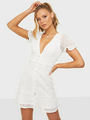 Kiss The Sky Blessed Lace Mini Dress