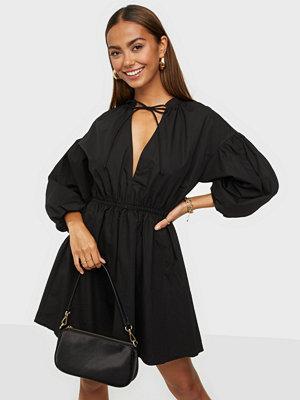 Glamorous Nelly x Glamorous Puff Sleeve Tie Mini Dress