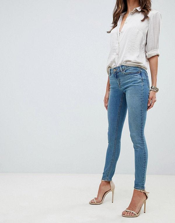 ASOS DESIGN Whitby Blå stentvättade skinny jeans med låg midja Blå stentvätt