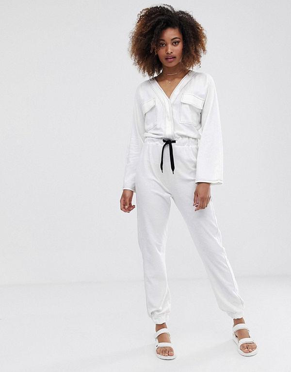 ASOS DESIGN Jumpsuit i jersey med fickor framtill och kontrastsöm