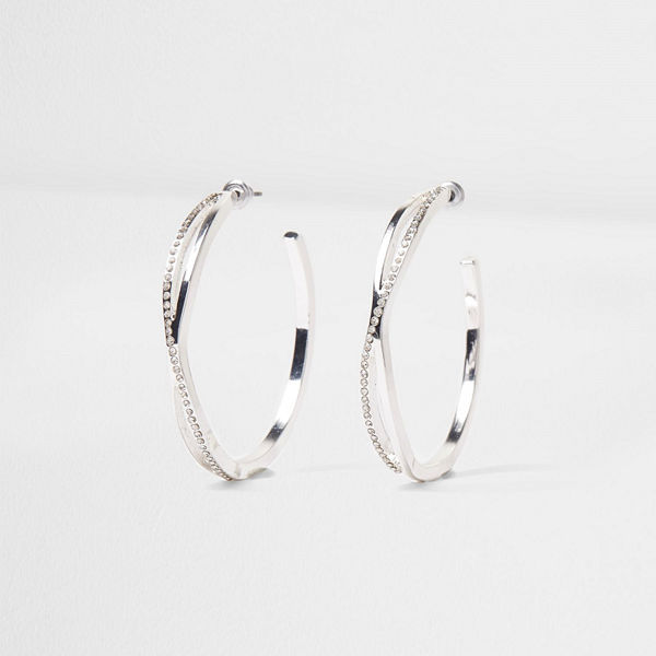 River Island örhängen Silver tone diamante pave twist hoop earrings
