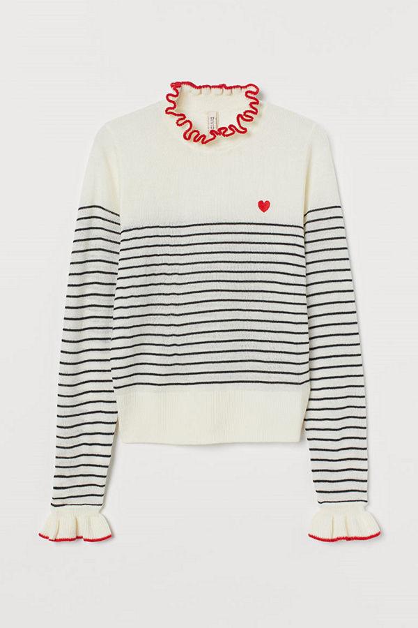 H&M Stickad tröja med volang vit