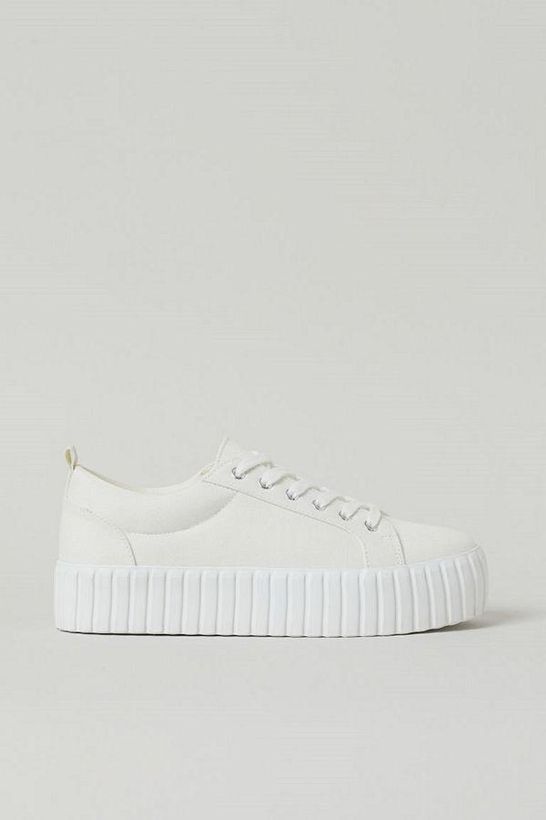 H&M Låga sneakers i canvas vit